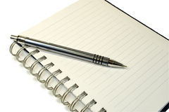 Notebook and ball pen. Royalty Free Stock Photo