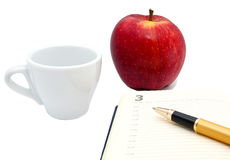 Notebook, ball pen, cup, apple isolated Stock Photo