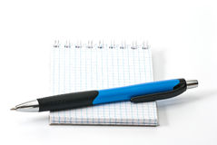 Notebook with ballpen. Blue ballpen on small notebook, isolated on white background Stock Image