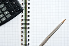 Notebook, ballpen and calculator Stock Photos