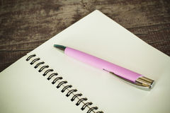 Notebook and ballpen Stock Images