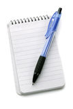 Notebook and ballpoint pen Royalty Free Stock Images