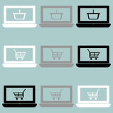 Notebook with basket and cart on the screen icon. Notebook with basket and cart on the screen icon set Stock Images