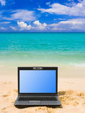 Notebook on beach. Computer notebook on beach - business travel background Stock Images