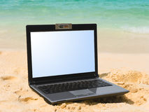Notebook on beach Stock Photography