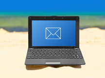 Notebook on beach. Computer notebook on beach - business travel background Stock Photo
