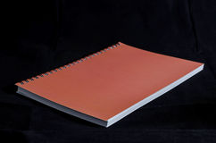 Notebook. Binded red cover blank notebook royalty free stock photography