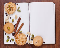 Notebook with biscuits Stock Image