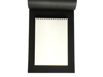 Notebook black. Notebook on a black sheet of paper Stock Image
