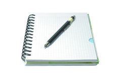 Notebook and black mecanical pencil isolated on wh. Notebook with black mecanical pencil isolated on white Stock Photo