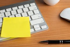 Notebook with black pen, Colorful notepads on the desk, Glasses on the desk with pen and cup of coffee, Computer keyboard with col. Notebook with black pen stock images