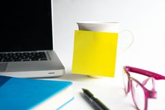 Notebook with black pen, Colorful notepads on the desk, Glasses on the desk with pen and cup of coffee, Computer keyboard with col. Notebook with black pen royalty free stock photos