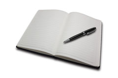 Notebook and a black pen. Royalty Free Stock Photos