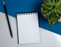 Notebook with a black pencil stock images
