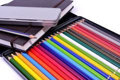 Notebook , black pencil and colored pencil Stock Photos