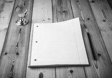 Notebook with black pencil and the glass globe on grey wooden ba Stock Images