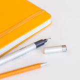 Notebook with black pencil and small depth of fiel Stock Images