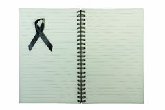 Notebook with black ribbon. Isolated on white background Stock Photography