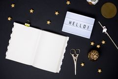 Notebook on a black table with a gold details stock photos