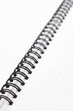 Notebook with black wire Royalty Free Stock Photos