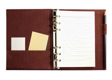 Notebook with blank card isolated Stock Images