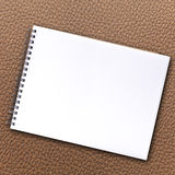 Notebook blank page. On leather textured stock photo