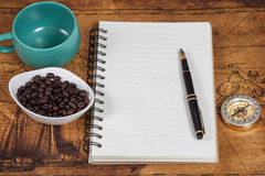 Notebook with blank pages, black pen and  pocket Stock Images