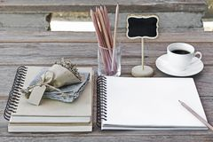 Notebook of blank pages with glasses, flower bouquet, pencils an Royalty Free Stock Photos