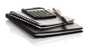 Notebook, blank pages for notes, calculator and pen isolated. Stock Photos