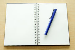 Notebook and Blue pen Royalty Free Stock Photography