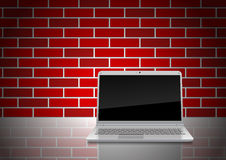 Notebook on the board against the wall. Illustration of modern laptop placed on a shiny plate against brick wall Stock Photography