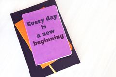 Notebook, book or diary with motivational quote: Every day is a. New beginning royalty free stock photos