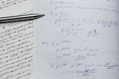 Notebook and book with mathematics equations and functions Stock Photos