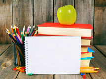 Notebook, books and school tools. Stock Photography