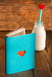 Notebook and bottle of milk with heart Royalty Free Stock Images