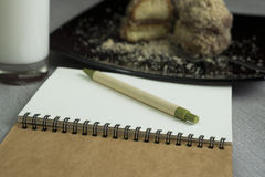Notebook and breakfast Stock Photography