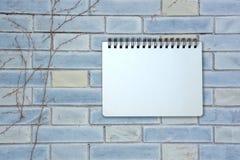 Notebook on brick pattern Stock Image