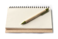 Notebook and brown pen Royalty Free Stock Image