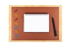 Notebook on brown textured paper imitating a frame Royalty Free Stock Image