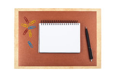 Notebook on brown textured paper imitating a frame Stock Images