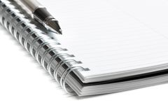 Notebook and business pen in composition Stock Photos