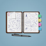 Notebook with business pen drawings Stock Photography