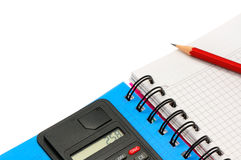 Notebook and calculator Stock Image