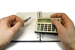 Financial accounting. Male hands holding a calculator Royalty Free Stock Image