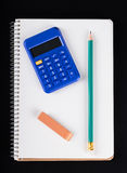 Notebook, calculator, eraser and pencil Stock Images
