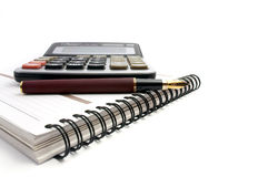 Notebook, calculator and fountain pen Royalty Free Stock Photo