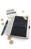 Notebook with calculator and pen Stock Images