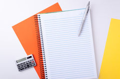 Notebook, calculator and pen Royalty Free Stock Photography
