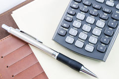 Notebook with calculator and pen Stock Image