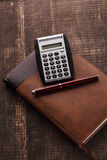 The notebook, calculator and pen Stock Images